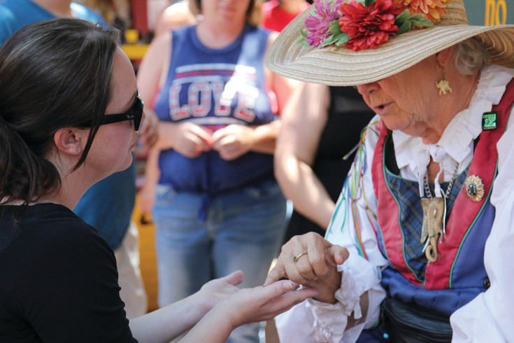 """Madam Carolyn"" reads palms at the Colorado Renaissance Festival on July 9."