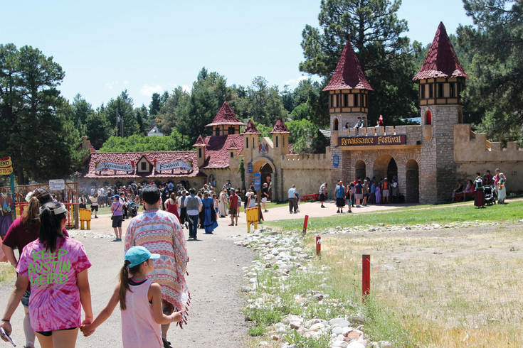 Crowds strea, into the Colorado Renaissance Festival on July 9.