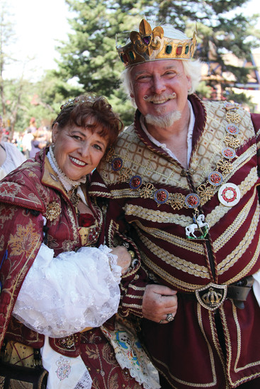 Queen Anne and King Henry stroll the Colorado Renaissance Festival village on July 9, greeting those in attendance.