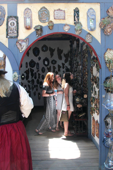 Vendors and artisans line the streets at the Colorado Renaissance Festival for event goers to browse amid other activities.