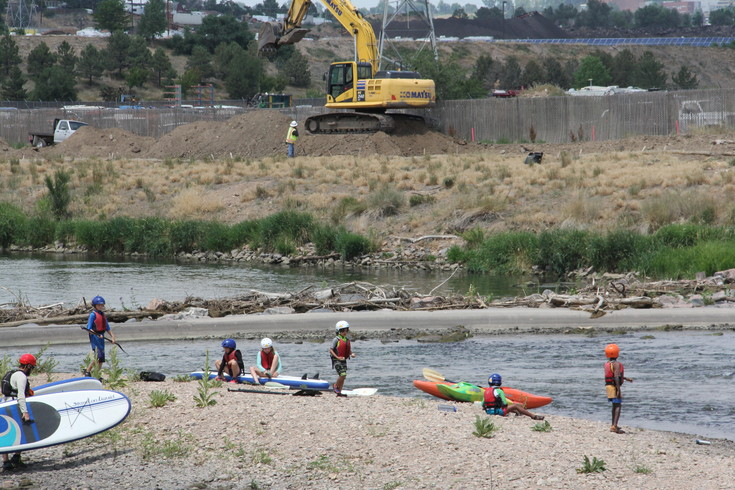 Kids getting ready to kayak at the South Platte River near its juncture with Big Dry Creek, where construction is underway on a new river trail July  7.