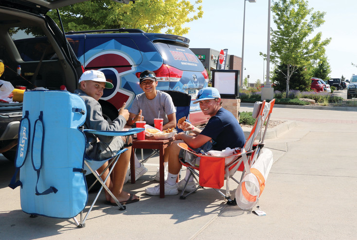 After camping out for nearly 24 hours, Braden Hall, left, Mason Hayashi and Dax Littleton munched enjoyed a meal of chicken fingers and fries from Raising Cane's, 1108 Corporal Max Donahue Lane. The 16-year-olds were among 20 customers at the July 6 grand opening to receive free food from the restaurant for a year.