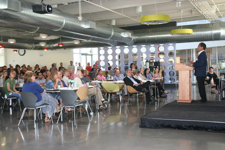 National Renewable Energy Laboratory (NREL) employees fill the facility's café on July 5 to hear a distinguished from Shuji Nakamura, who was part of the team that won the Nobel Prize in Physics in 2014 for the invention of efficient blue light-emitting diodes (LEDs).