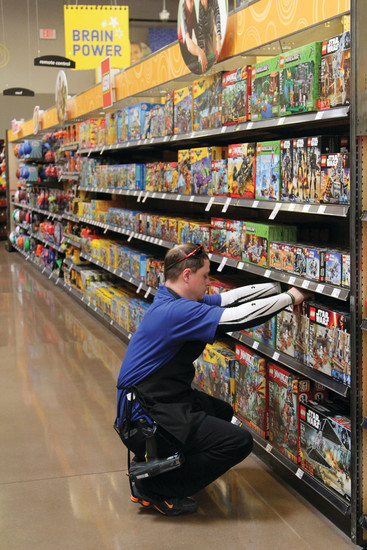 Cameron Parker, who's worked with the Castle Rock King Soopers Marketplace since it opened, organizes the toy aisle on July 7.