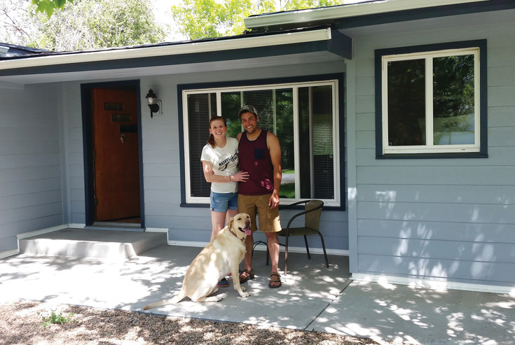 Mark Suda, right, a local arborist, stands with his girlfriend Audrey Young and their dog Copper outside of their Wheat Ridge home.