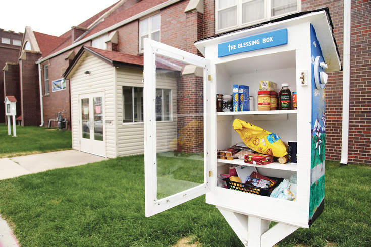 The Blessing Box outside The Rising Church encourages residents to take what you need and leave what you can.