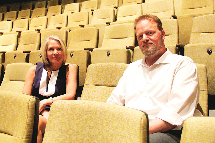 Parker Arts Cultural Director Elaine Mariner and Program Manager Shaun Albrechtson sit in the PACE Center theater. The recently announced Parker Arts 2017-2018 season features more stand up comedy than in years past, in addition to the annual performances by local groups and nationally known musical and theater productions.