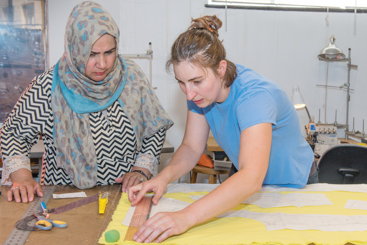 "Artists Sweeta Afrooz and Jessica Shaver create a dress for ""Designing Women: a Cross-Cultural Collaboration in Support of Local Refugee Designers,"" an event at Space Gallery on July 21."