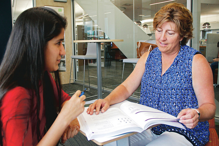 Sunita Safi, left, reviews her science homework with Kathy Denson in a study room at the Douglas County Libraries Parker branch. Denson has tutored four students since beginning her volunteer service with the Douglas County Libraries Adult Literacy Program in 2015.