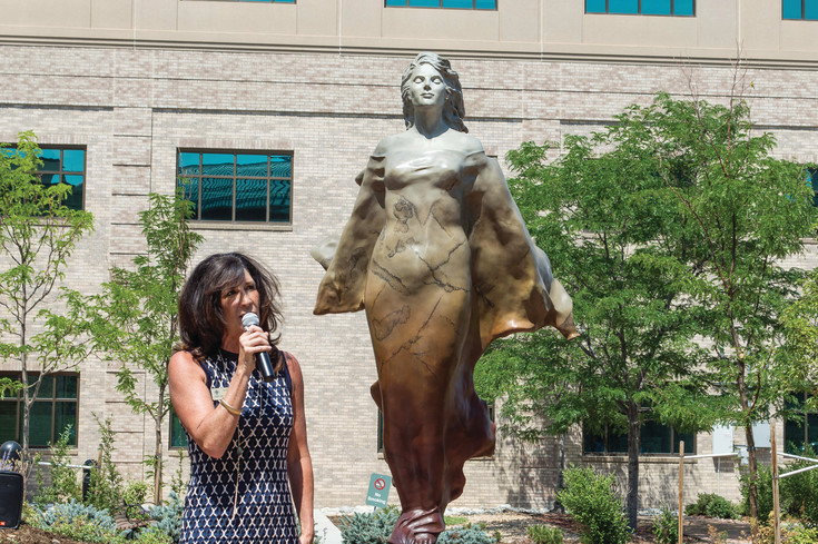 Mayor Jackie Millet speaks at the unveiling of Transcendence, a sculpture by Scy Caroselli, at the healing garden of Sky Ridge Medical Center on July 7.