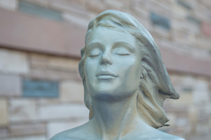 The face of Transcendence, a sculpture by Scy Caroselli, was carefully sculpted to imitate complete serenity.