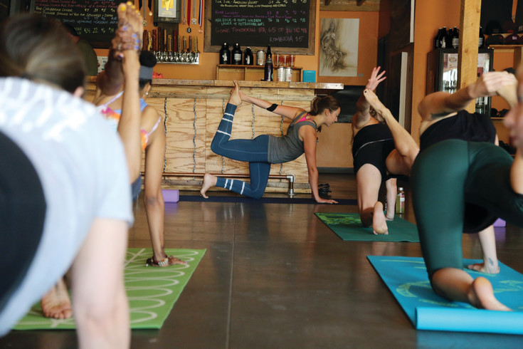 Allie Beckmann teaches yoga at Odyssey Beerwerks July 8.