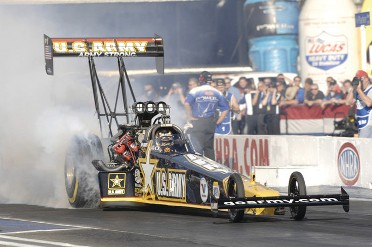 Tony Schumacher, driver of the U.S. Army top fuel dragster, spins the tires to heat them up so they grip the track better. Schumacher returns to Bandimere Speedway July 21-23 to defend the Mile High National event title he won last year.