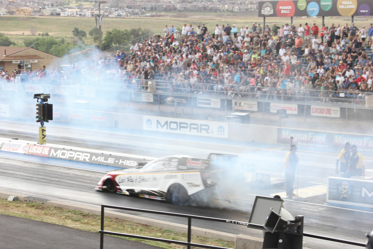 Driver Tim Wilkerson smokes the tires as he prepares to make a top fuel funny car timing run at last year's Mile High National Drag Races at Bandimere Speedway in Morrison. The Mile High Nationals return to Bandimere July 21-23.