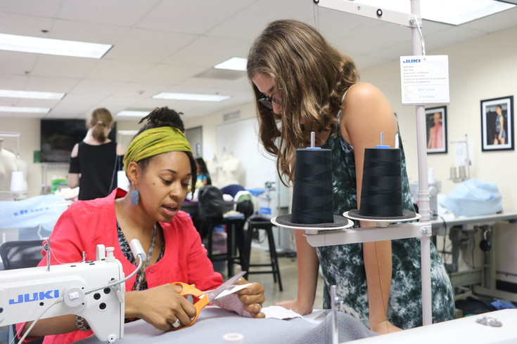 Sarah Naomi Jones explains gives advice on making crisper corners during the Athena Project's fashion design summer camp in the Rocky Mountain College of Art + Design's Sewing Room on July 12.