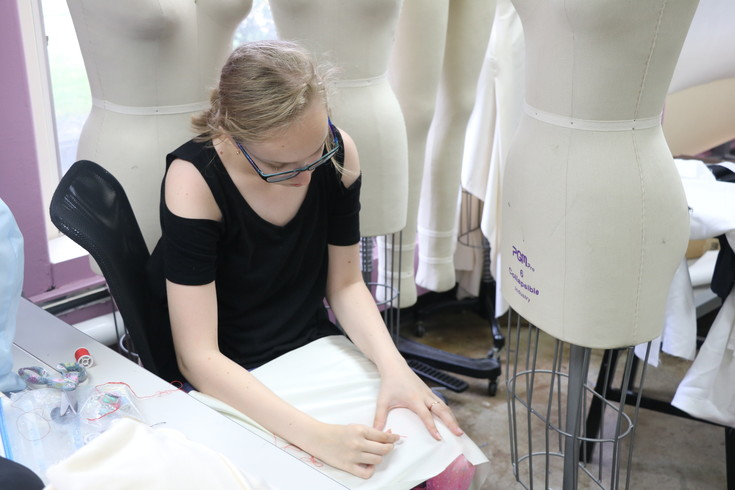 Isabella Pettyjohn, a 13-year-old from Highlands Ranch, works on a dress inspired by Star Wars' Princess Leia during the Athena Project's fashion design summer camp in the Rocky Mountain College of Art + Design's Sewing Room on July 12.