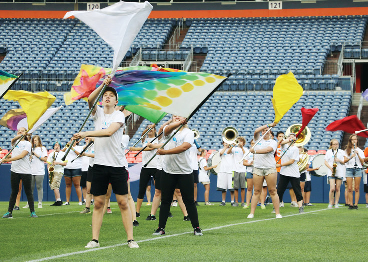 Members of BKXperience, an educational clinic hosted by Ascend Performing Arts, lead the opening ceremony of Drums Along the Rockies on July 15 at Sports Authority Field at Mile High. At the clinic, students learn performance techniques from the Blue Knights, Denver's drum and bugle corp.