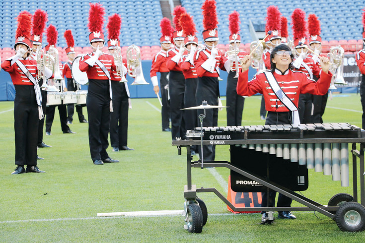The Battalion, a marching band from Utah, put on a colorful performance at the 54th Drums Along the Rockies at Sports Authority Field at Mile High on July 15. The group was one of 10 national drum and bugle corps to perform at the annual event.