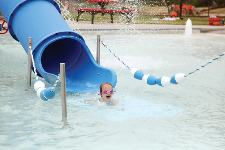 Olivia Callaghan screams with excitement after sliding down the pool slide at Secrest Pool.