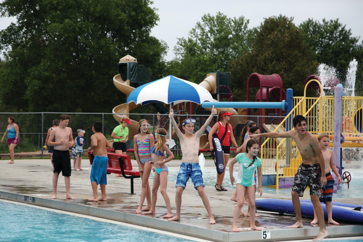 Kids get ready to dive for pennies at the Mid Summer Pool Party at Secrest Pool.
