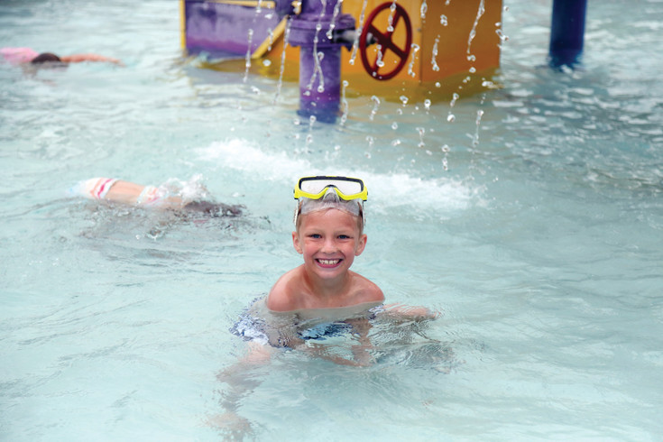 Zeke Downey, 6, dives for pennies at the Secrest Pool mid summer party July 12.