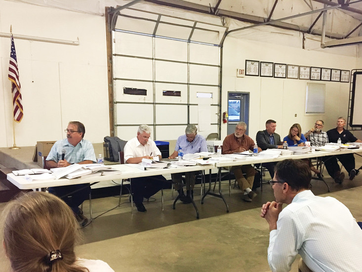 The nine members of the Elbert County Planning Commission listen to information regarding the Independence community applications at the July 11 planning commission meeting at the Kiowa Fairgrounds.