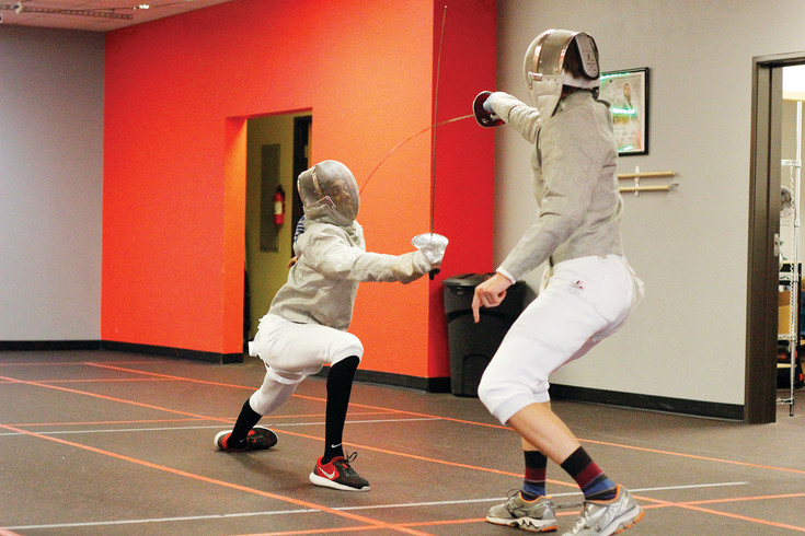 Castle Rock's David Smith, 15, lunges at his opponent, Matt Waid, 16, of Parker, as Waid scores against him. Smith said participating in the national tournament in Utah, which attracted 8,440 entrants, opened his eyes to how diverse and how popular fencing is in the United States.