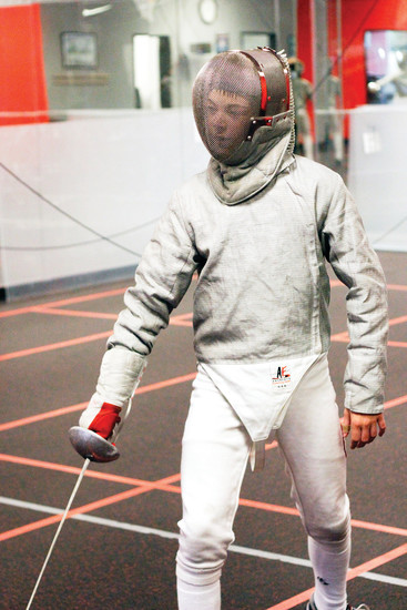 "Nico Pope, 12, of Castle Rock prepares to spar with an opponent during a practicie session. Pope's mother was a fencer in her day and says he took it up to see if he could do it and because of his affinity for the film ""The Princess Bride."""