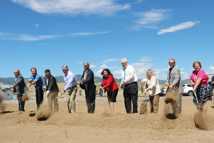 Key players of Sterling Ranch, including developers, architects, business leaders and Douglas County commissioners, shovel the first round of dirt at the site of a future civic center. The July 21 groundbreaking ceremony celebrated the development's first commercial building, slated for completion in spring 2018.