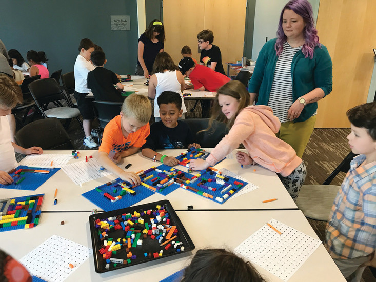Kids at the Anythink Library's Huron branch invented their own board games this summer, one of the many actities the library network hosted this summer. Anythink is celebrating the end of its summer programs with distinct celebrations at each of the library branches.
