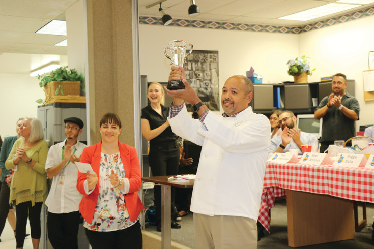 Reggie Bicha, executive director of Colorado's Department of Human Services, announces Mount View Youth Service's chefs, James Cronin and Dina Lampropoulou, as the winners of the third annual Great CDHS Cook-Off on July 19.