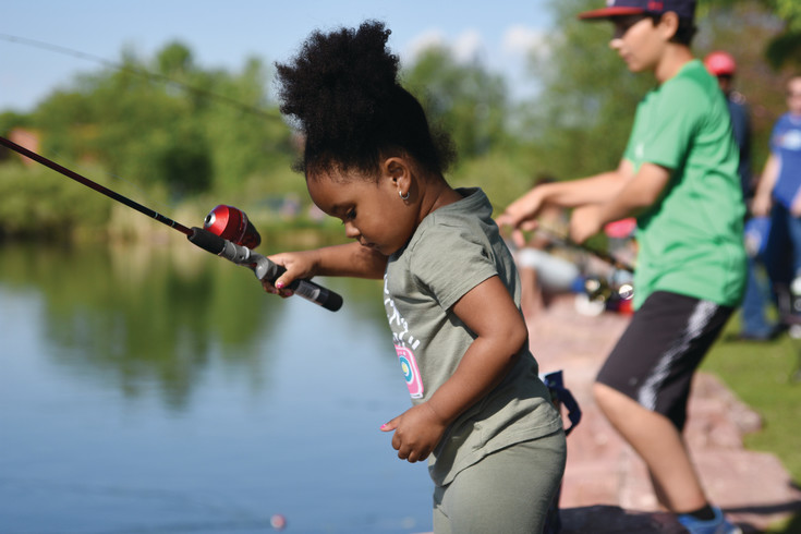 Sky Miller, 3, of Broomfield, checks her line, during Northglenn's 29th annual Fishing Derby this year.