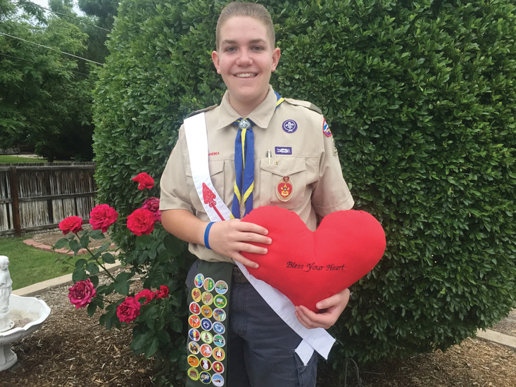 Philip Miller, 16, of Applewood holds up a heart-shaped pillow that is part of his Boy Scout Eagle project. The pillow is one of 204 that Miller is making to give to patients at Children's Hospital who get open heart surgery.