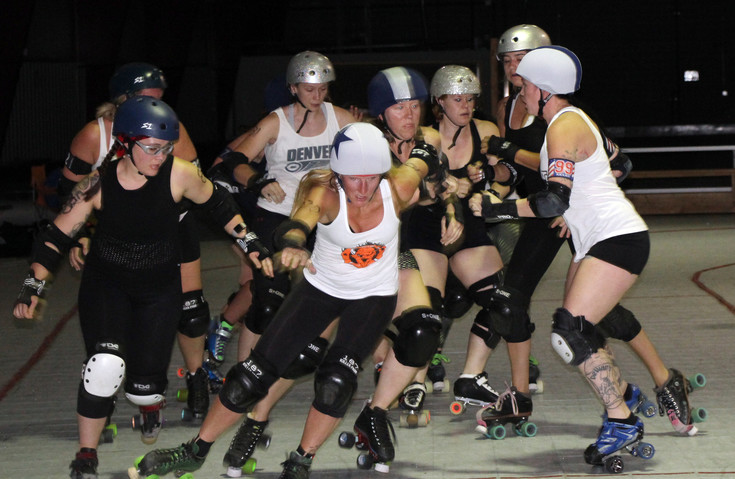 A jammer in the white jersey with the star on her helmet speeds up to make it past a would-be blocker during one of the matches called jams that took place at the Denver Roller Derby practice and scrimmage. The DRD has more than 100 members taking part in the fast-pace, physical sport. The membership includes players on three women's team, the men's team and the junior team for skaters 18 and under.