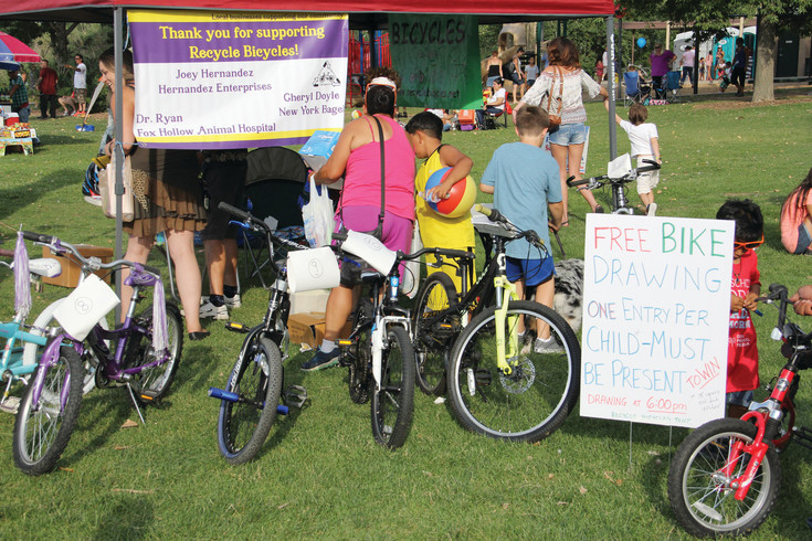 Bikes lined up for a free giveaway at the Harvey Park summer festival July 22. The giveaway was organized by Recycle Bicycles, a nonprofit program.