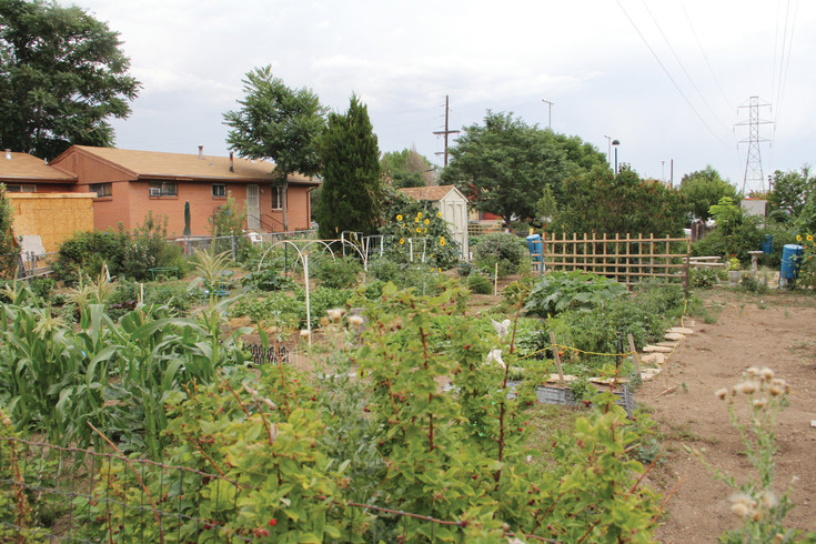 A community garden July 20 at South Lowell Boulevard and West Tennessee Avenue, owned by the Southwest Improvement Council nonprofit. SWIC bought a plot of land in the 1990s on which the garden sits.