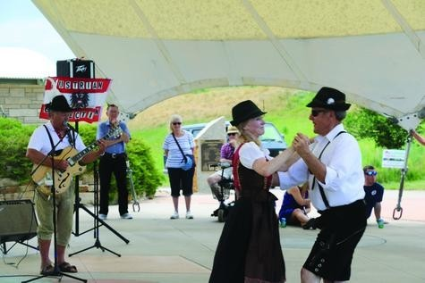 Conradt and Jeri Fredell dance a polka during German Fest Denver on July 22. The pair have a five-piece polka band, and both said they love the traditional music that comes from Germany.