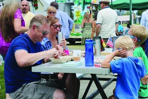 Rob, Jenny, Jacob and Ryan Couture, from Brighton, enjoy a traditional German lunch at the annual German Fest Denver on July 22.