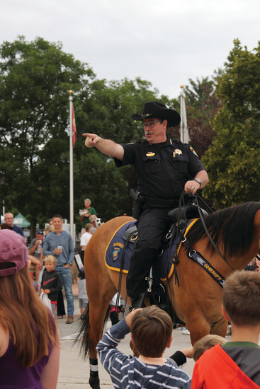 Sheriff Tony Spurlock greets the crowd during the Castle Rock parade on July 29.