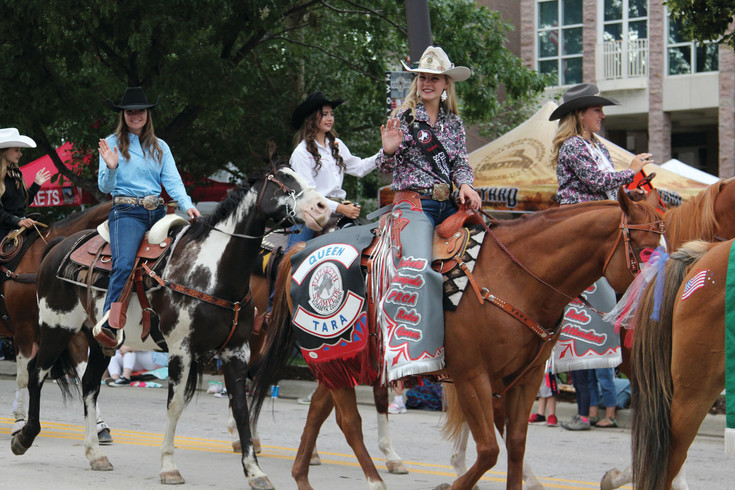 Rodeo royalty joined the train of floats at the Castle Rock parade.