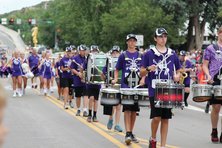 Marching bands and cheerleaders entertained parade goers during the Castle Rock fair parade on July 29.