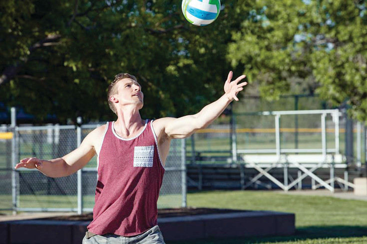 A volleyball player serves the ball during  Red Rocks Church sports ministry's volleyball tournament. Pairing faith and sport is a large ministry at Red Rocks Church. The sporting events are a way for someone to be introduced to the gospel. People may be intimidated by going to a church service, but they will feel more comfortable meeting people and learning about God through a sports team, said the sports program coordinator.