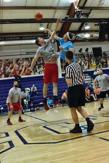 A basketball player shoots the ball during  Red Rocks Church sports ministry's basketball tournament.