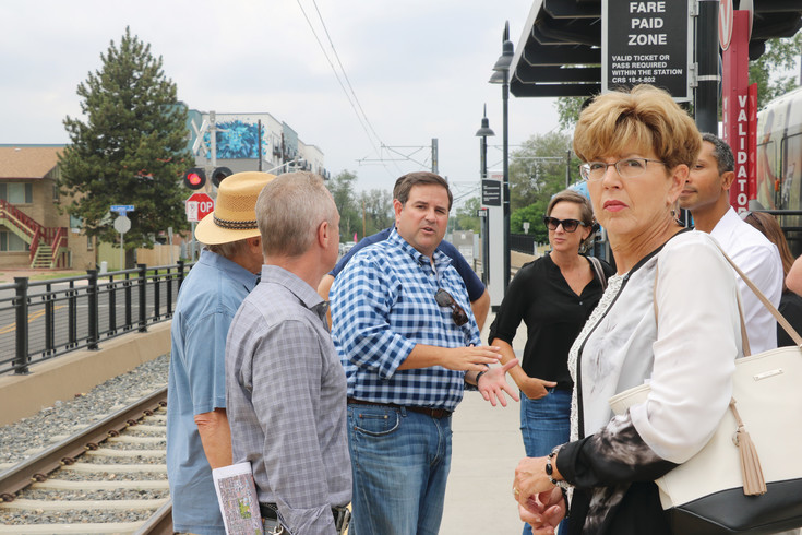 Lakewood Mayor Adam Paul, center, points out some of the growth along the W Line to Chris Nevitt, city-wide manager for transit-oriented development at City and County of Denver, and Tom Feldkamp, mayor of Bow Mar. The Metro Mayors Caucus took a ride on the W Line on July 26 to see some of the growth and opportunities in Denver, Lakewood and Golden along the line.