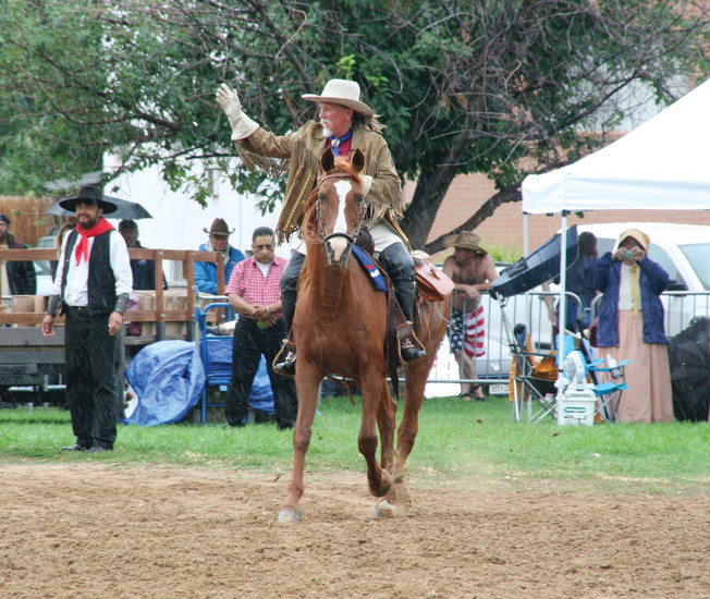 Famous showman William F. Cody, aka Buffalo Bill, rides out to greet the hundreds of people gathered at Lions Park ballfields in Golden on July 29 to watch Monarch Productions' Cody's Wild West show.