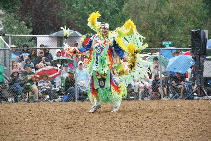A Native American performing with Monarch Productions' Cody's Wild West show dances a men's fancy dance on July 29 during Buffalo Bill Days in Golden.