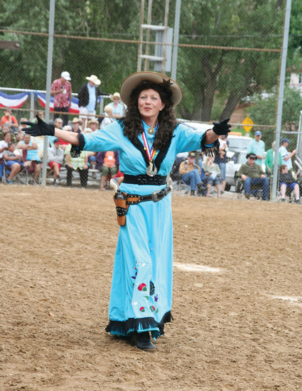 Little Sure Shot Annie Oakley greets the crowd before her sharp-shooting performance part of Monarch Productions' Cody's Wild West show on July 29 during Golden's Buffalo Bill Days celebration.