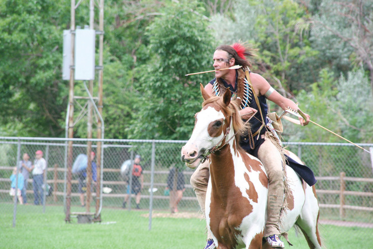 "Clint ""Rides His Horse"" Chartier does a buffalo hunt reenactment during Monarch Productions' Cody's Wild West show on July 29, which was part of the Buffalo Bill Days celebration in Golden."