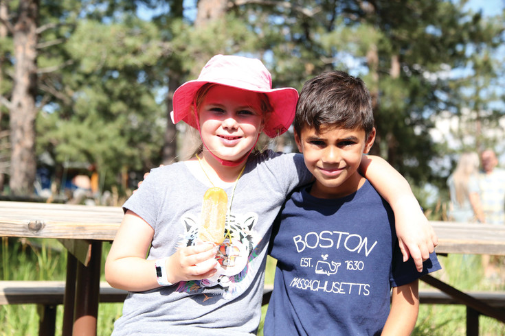 Maia Maestas and Matthew Thomas take a break from the heat with popsicles from Peak Pops.