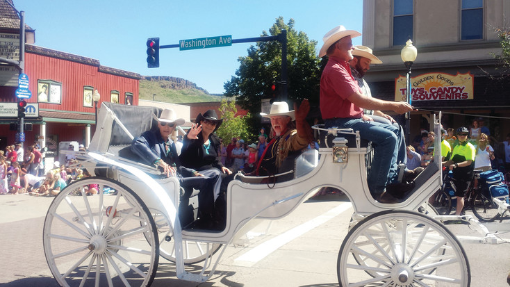 Colorado Community Media's John Tracy, and his wife, Jane, left, ride in a carriage with Buffalo Bill, right, along Washington Avenue in the 2015 Best of the West Parade. The Tracys were honored as the grand marshals in the parade for their commitment and volunteerism in the Golden community.
